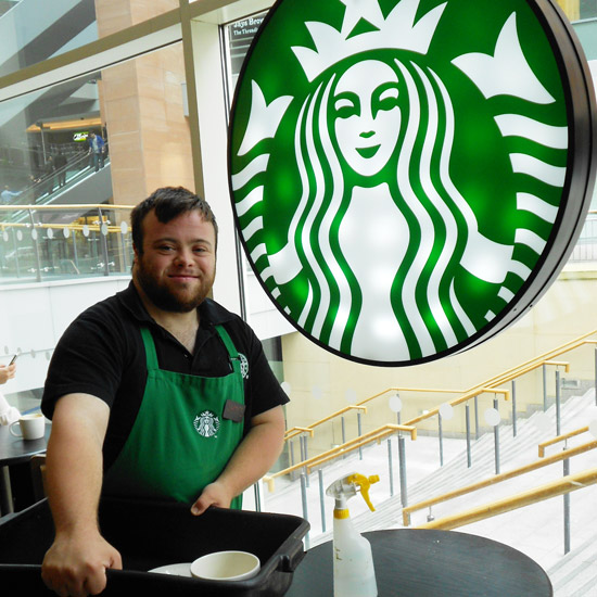 Participant working in Starbucks