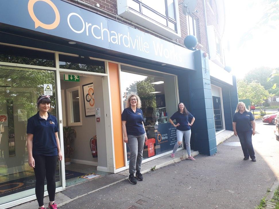 Staff outside Ordchardville Works project in Belfast